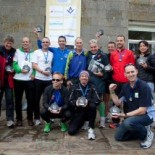 Mark with fellow runners who complete the 10 in 10. Legendary fell runner Joss Naylor is pictured in the centre